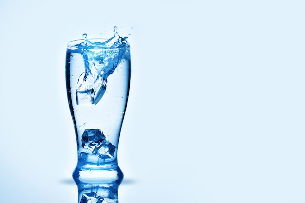 The ice cubes lapping in water glass. water splashes,