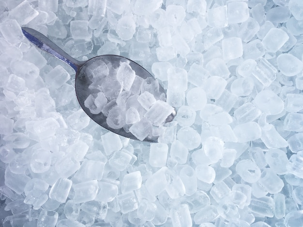 Ice cubes and stainless ice scoop