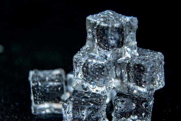 Ice cubes water on a black background isolation / close up
