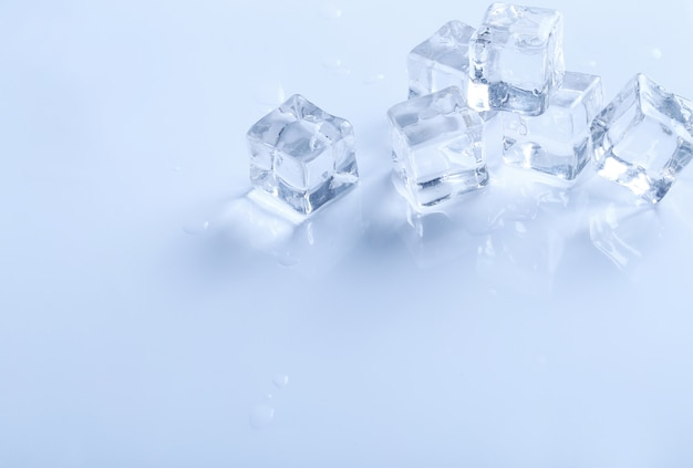 Ice cubes on white surface with copyspace