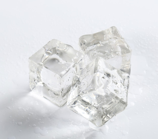 Ice cubes on white table