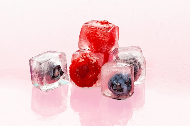 Ice cubes with berry for summer cocktails