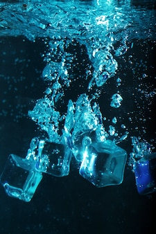 Ice cubes with bubbles underwater