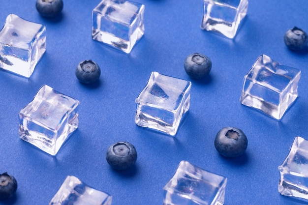 Ice cubes with fresh blueberries
