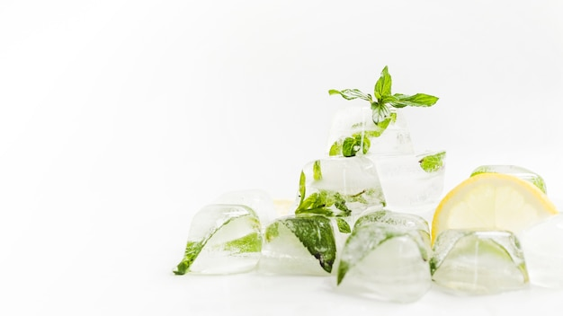 Ice cubes with mint and slice of lemon