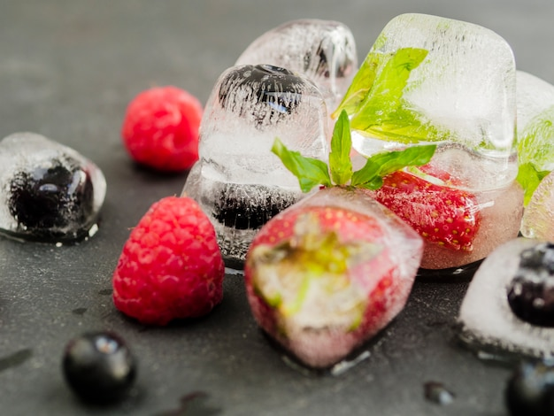 Ice cubes with strawberry blueberry and raspberry