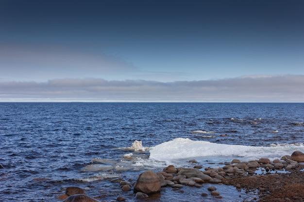 Ice drift on the lake spring ice melting