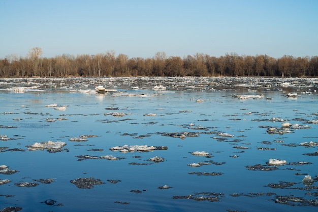 Ice floats down river. background image of melting ice. thawing of ice in spring season.