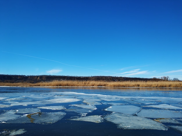 Ice floes float on the river. thaw at the end of winter.