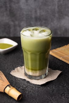 Ice green tea latte food background