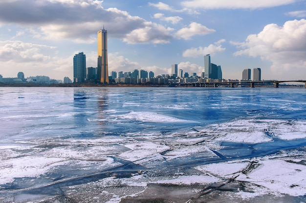 Ice of han river and cityscape in winter,sunset in seoul, south korea.