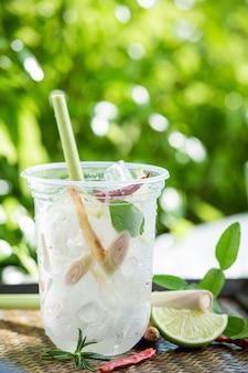 Ice herbal tea on wooden surface