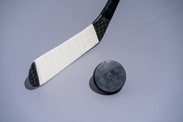 Ice hockey stick and puck on isolated white background