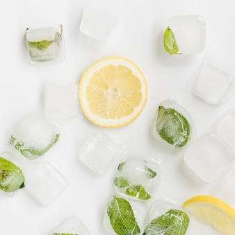 Ice and lemon on white background