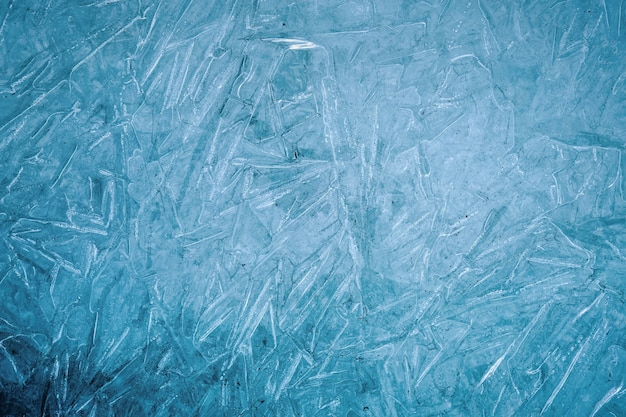 Ice natural textured blue background close up