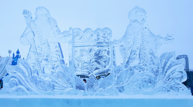 Ice sculptures of santa claus and snow maiden