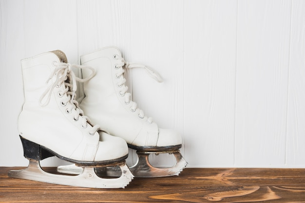 Ice skates on wooden tabletop
