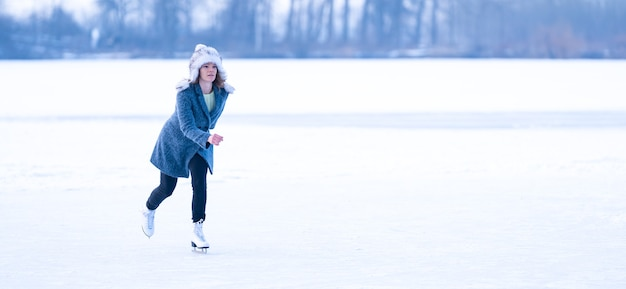 Ice skating on a frozen pond in winter banner