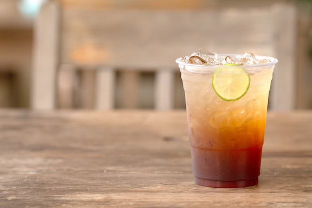 Ice tea with lemon and honey summer drink