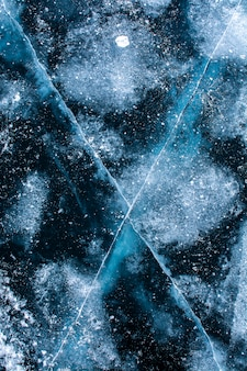 Ice texture on surface of frozen lake, nature background image