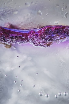 Ice with lilac colored tonic