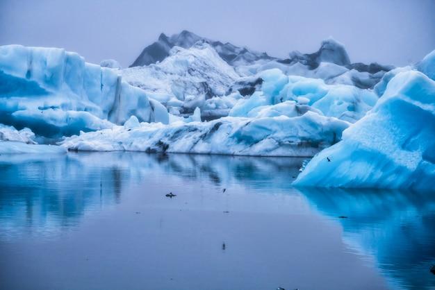 Icebergs in jokulsarlon glacial lagoon in iceland.