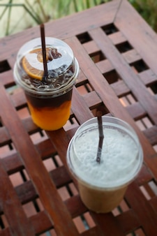 Iced americano coffee with fresh orange juice drink, stock photo