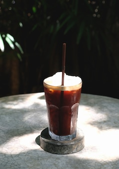 Iced americano on rock table