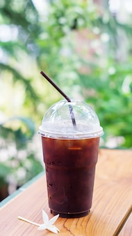 Iced black coffee on the wooden table.