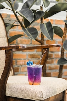Iced butterfly pea tea with lemon on chair, relax time.