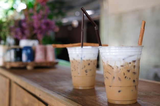 Iced cappuccino coffee with milk on cafe counter