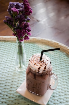 Iced chocolate on glass table top