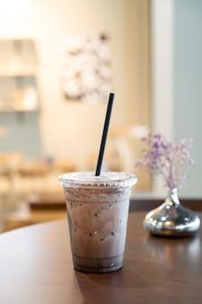 Iced chocolate milkshake in coffee shop cafe