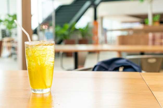 Iced chrysanthemum juice on wood table in cafe restaurant