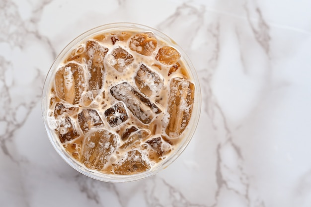 Iced coffee in cup plastic top view close up