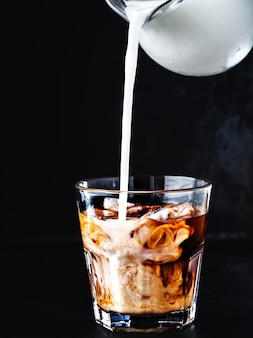 Iced coffee in a glass with ice and sugar syrup