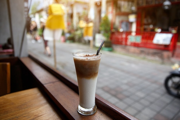 Iced coffee on summer terrace of the cafe.