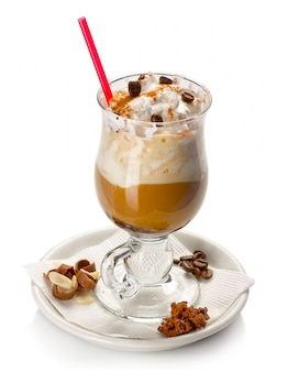 Iced coffee with ice-cream topping isolated