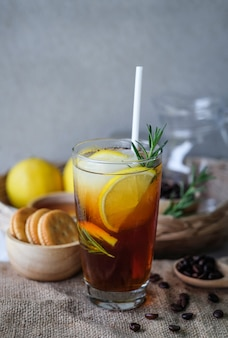Iced coffee with lemon and rosemary