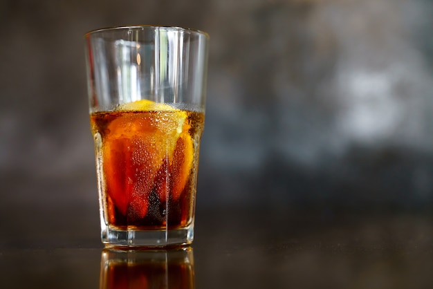 Iced cold brew coffee with slice of orange