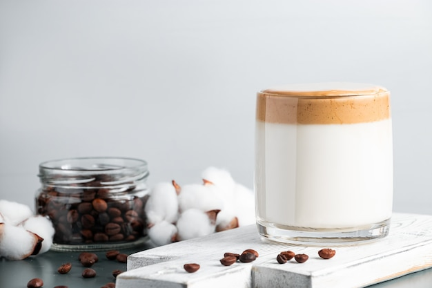 Iced dalgona coffee glass of trendy fluffy drink made from milk and whipped cream