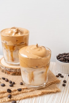 Iced fluffy creamy whipped drink with coffee foam and milk