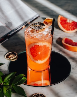 Iced grapefruit cocktail on the table