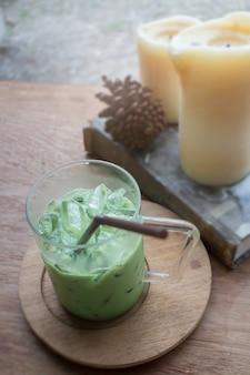 Iced green tea latte on wooden table