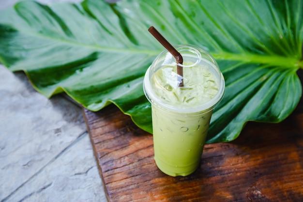 Iced green tea in takeaway cup