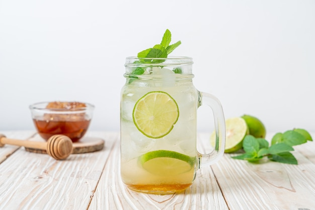 Iced honey and lime soda with mint - refreshing drink