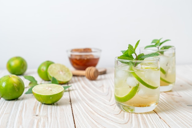 Iced honey and lime soda with mint. refreshing drink