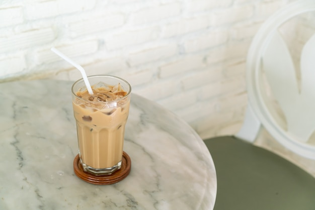 Iced latte coffee glass on table in coffee shop cafe