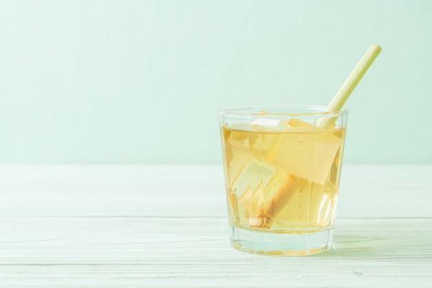 Iced lemon grass juice on wood background