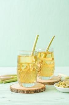 Iced lemon grass juice on wooden table
